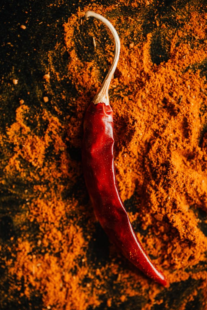 red-chilli-pepper-on-powder-of-ground-spices-4198417